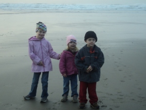 Three of my kids at Nye Beach, one of my favorite places in Oregon.