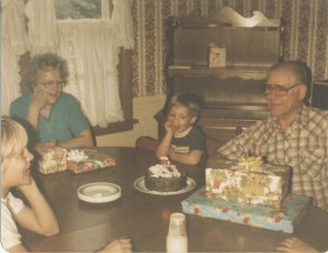 "Celebrating my Grandpa's birthday in our kitchen in our Indiana house.  Will always remember the ""vegetable wall paper."""